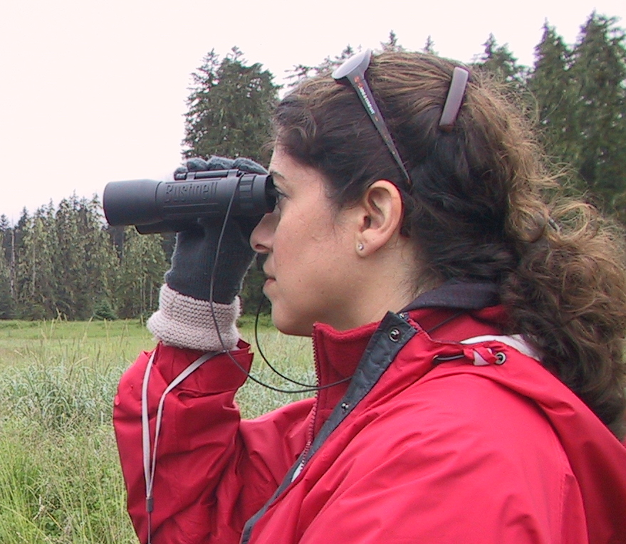 Ms. Lubowe in Alaska with binoculars
